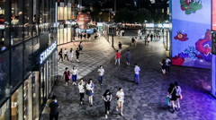 Fashion young people wander the Sanlitun Village shopping center in Beijing Stock Footage