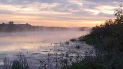Stock Video Footage camera slide morning mist over the river Stock Footage