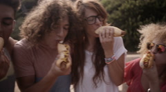Friends Eating Hotdogs Stock Footage