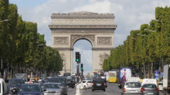 Traffice on Champs elysees Paris with triumphal arch in background Stock Footage