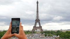 Taking picture of Eiffel tower in Paris with smartphone - stock footage
