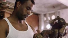 9of9 African american sculptor, artist, art, wood, sculpture, work review - stock footage