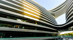 Walking along Galaxy SOHO shopping center near the Second Ring road in Beijing - stock footage