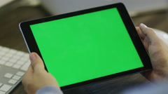 Designer using Digital Tablet with Green Screen at Work in Landscape Stock Footage