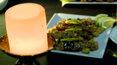 Romantic dinner with salmon trout and candle Stock Footage