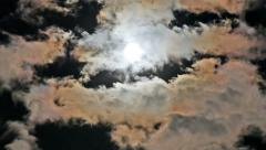 Full Moon behind Iridescent Clouds - stock footage