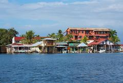Houses over water with boats in bocas del toro Stock Photos