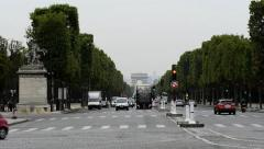 Traffic streams down the Champs Elysees Stock Footage