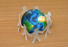 Paper cut of people standing in a circle around globe on wooden floor (elemen Stock Illustration