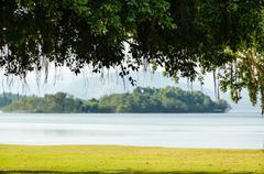 landscaped lawns for leisure on a kaeng kra chan lake - stock photo