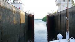 Pasinger Boat transport through lock on Volga river timelapse Stock Footage