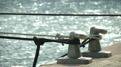Mooring bollard and ropes  Stock Footage