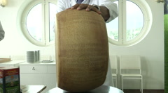 Man opening Parmesan cheese wheel  Stock Footage