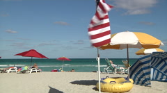 American flag waving on a beach in Miami  Stock Footage
