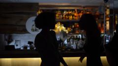 Silhouettes of girls at the bar Stock Footage
