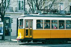 Stock Photo of typical yellow tram in chiado district in lisbon, portugal