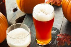 frothy orange pumpkin ale - stock photo