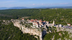 Aerial - Seaside village on the edge of a cliff. Destination scenic, Lubenice Stock Footage