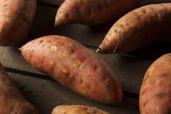 Organic raw sweet potatoes Stock Photos