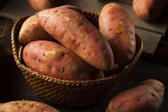 organic raw sweet potatoes - stock photo