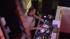 Dj playing turntables - stock footage