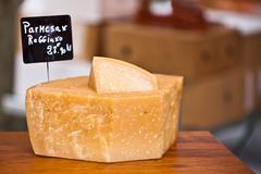 chunk of cheese at outdoor market - stock photo