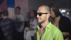 Guy in sunglasses dancing in the club Stock Footage