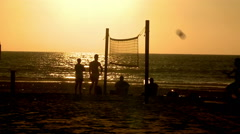Sport. Foot volley. Young people playing footvolley, beach soccer on the sunset Stock Footage