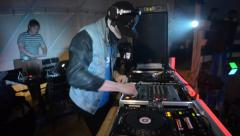 DJ skull wearing a mask plays turntables Stock Footage