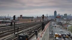 Queens New York City Skyline Subway Train Approaching Station Busy City Traffic Stock Footage
