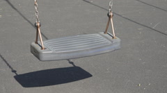Empty swing playground urban park sunny summer day no child cradle chain symbol  Stock Footage