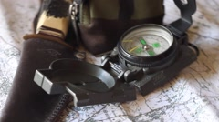 Stock Video Footage of Map and Compass Turning
