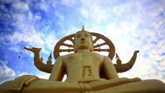Time lapse golden Buddha statue against blue sky with moving clouds in Samui Stock Footage
