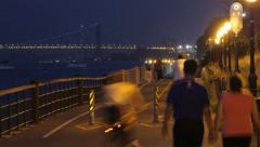 TIME LAPSE RUNNERS BICYCLISTS NIGHT GW BRIDGE Stock Footage