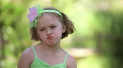Stock Video Footage of Closeup Of Little Girl Making Different Faces, Grumpy, Sad, Happy