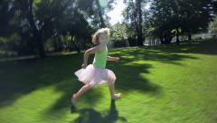Little Girl Runs Through An Open Field Stock Footage