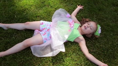 Little Girl Lays In The Grass, Happily Day Dreaming - stock footage