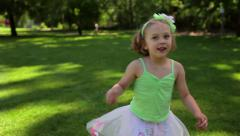 Cute Little Girl Twirls And Jumps Through The Air In Her Dress Up Clothes Stock Footage