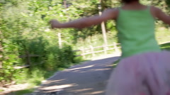 Little 5 Year Old Girl Skips Down A Park Path In Her Dress Up Clothes Stock Footage