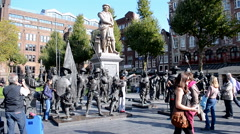Musketeer (musketry) and rembrandt monument in Amsterdam, Nethrlands, Stock Footage