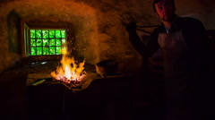 Blacksmith prepares the fire to start working Stock Footage