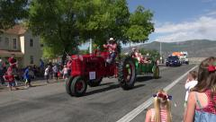 Rural community parade antique tractor candy kids 4K 231 Stock Footage