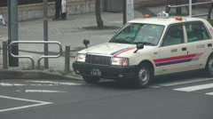 White Taxi Car Driver The Urban Streets Of Tokyo 4K Stock Footage