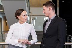 businesswoman flirting with her workmate - stock photo
