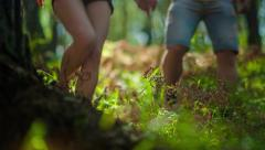 Young couple hiking in the forest Stock Footage
