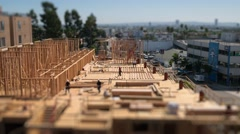 Stock Video Footage of Workers building construction site Los Angeles Tilt shift miniature timelapse