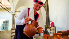 Turkish made poring the drink in to clay jars Stock Footage