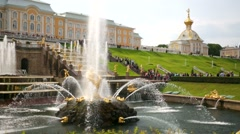 Tourists visit fountains and gardens at Peterhof. - stock footage