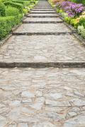 stone pathway pass through a garden - stock photo