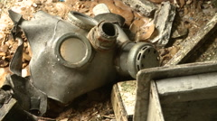 Small children's gas mask in an abandoned kindergarten in ghost town Pripyat. - stock footage